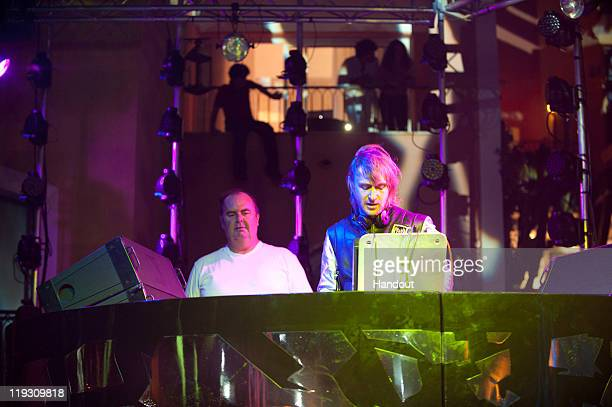 DJ Jack E and David Guetta perform during Hotel Byblos Summer Party at Hotel Byblos on July 13 2011 in SaintTropez France