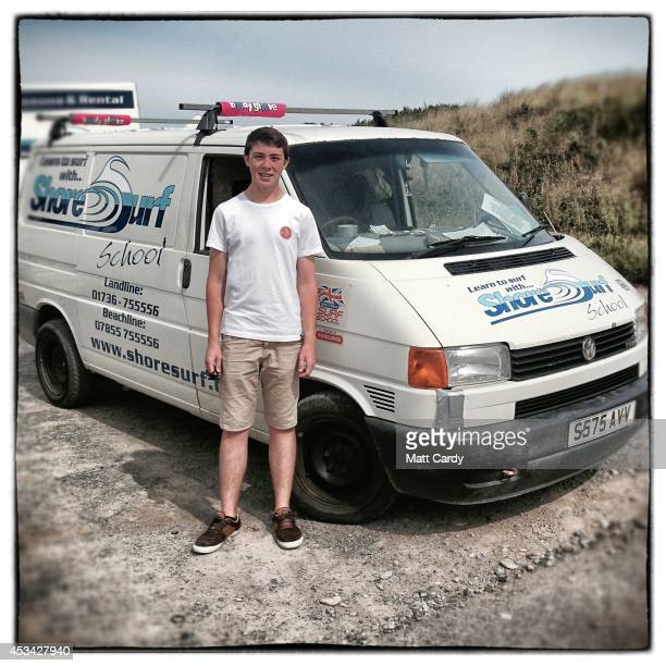 Jack Eggleston from Cornwall poses for a photograph besides his employer's 1998 fourth generation T4 Volkswagen Transporter van near Newquay on...
