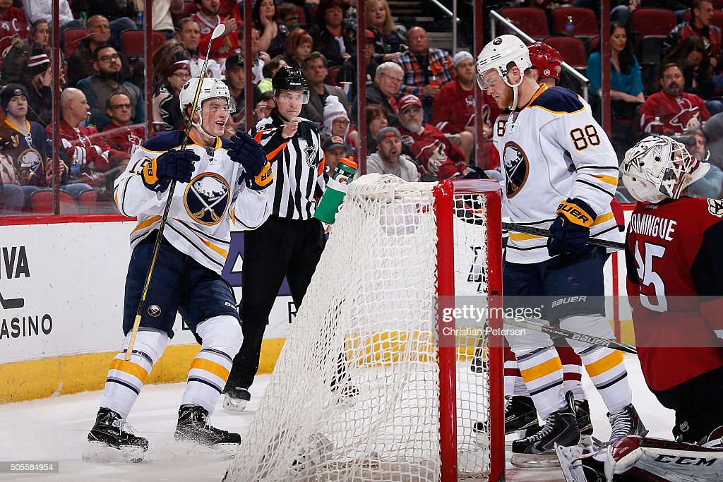 Jack Eichel and Jamie McGinn of the Buffalo Sabres celebrate after McGinn scored a second period power play goal past goaltender Louis Domingue of...