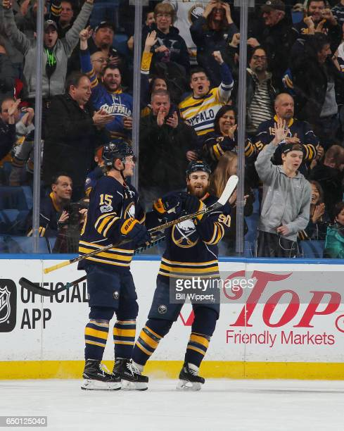 Jack Eichel and Ryan O'Reilly of the Buffalo Sabres and fans celebrate a goal against the Arizona Coyotes during an NHL game at the KeyBank Center on...