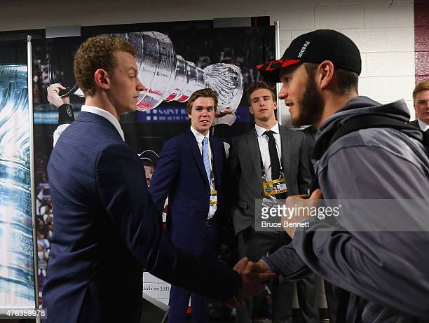 Jack Eichel Connor McDavid Noah Hanafin and Chicago Blackhawk Jonathan Toews chat following a media availability at United Center on June 8 2015 in...
