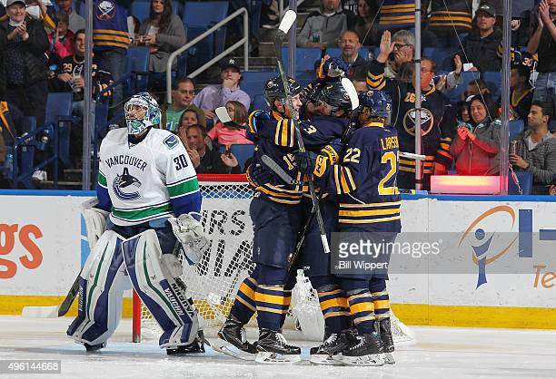 Jack Eichel Mark Pysyk and Johan Larsson of the Buffalo Sabres celebrate a second period goal by Jamie McGinn against Ryan Miller of the Vancouver...