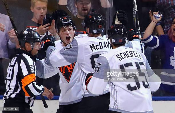Jack Eichel of Team North America celebrates his goal at 503 of the first period against Team Finland and is joined by Connor McDavid and Mark...