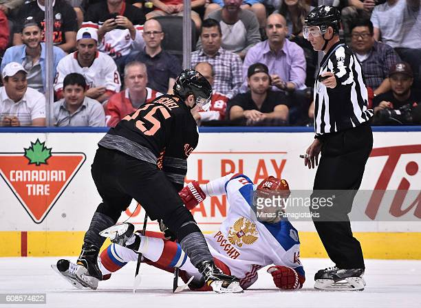 Jack Eichel of Team North America knocks Artem Anisimov of Team Russia to the ice during the World Cup of Hockey 2016 at Air Canada Centre on...