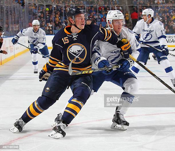 Jack Eichel of the Buffalo Sabres and Erik Condra of the Tampa Bay Lightning battle for position on October 10 2015 at the First Niagara Center in...