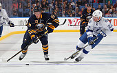 Jack Eichel of the Buffalo Sabres carries the puck against Erik Condra of the Tampa Bay Lightning on October 10 2015 at the First Niagara Center in...
