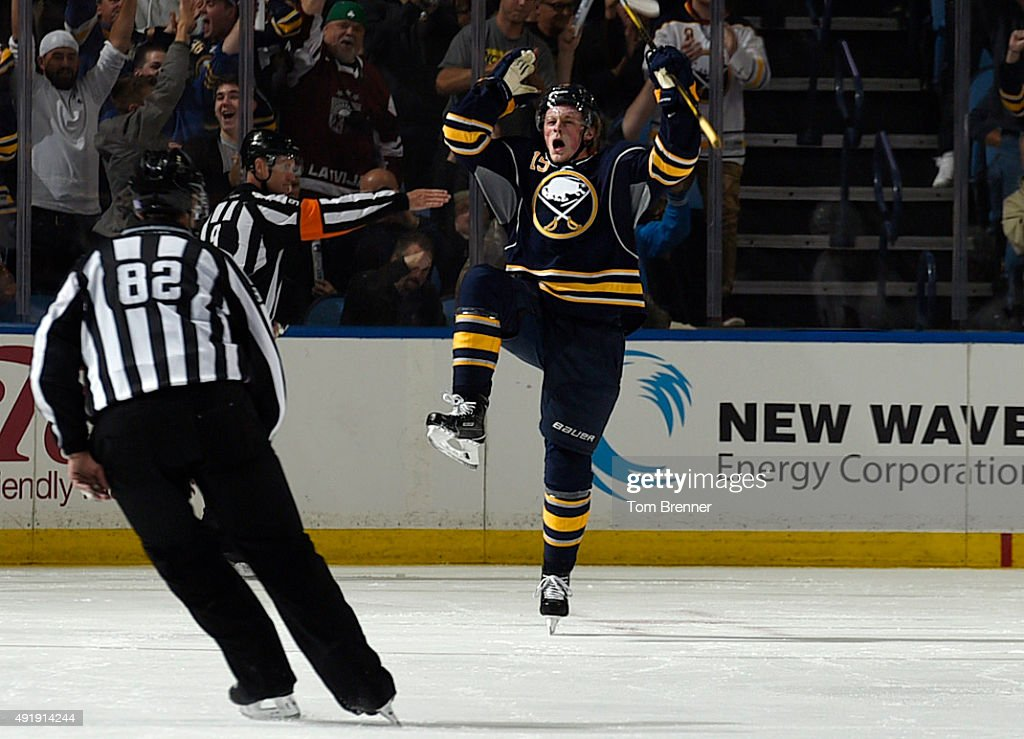 Jack Eichel of the Buffalo Sabres celebrates after scoring his first goal during a game against the Ottawa Senators at the First Niagara Center on...