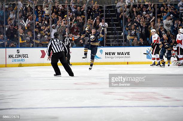 Jack Eichel of the Buffalo Sabres celebrates after scoring his first career goal during a game against the Ottawa Senators at the First Niagara...