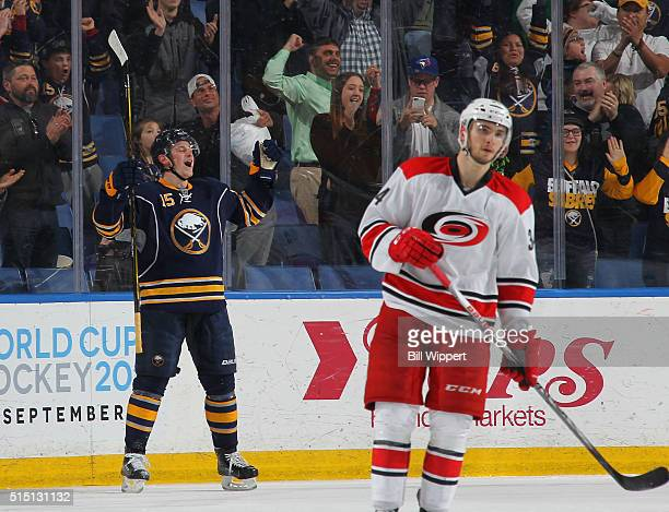 Jack Eichel of the Buffalo Sabres celebrates after scoring the gamewinning goal with one second remaining in overtime as Phillip DiGiuseppe of the...