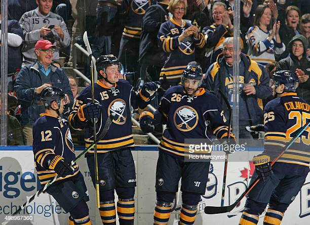 Jack Eichel of the Buffalo Sabres celebrates his second period goal against the Carolina Hurricanes with teammates Brian Gionta and Matt Moulson...