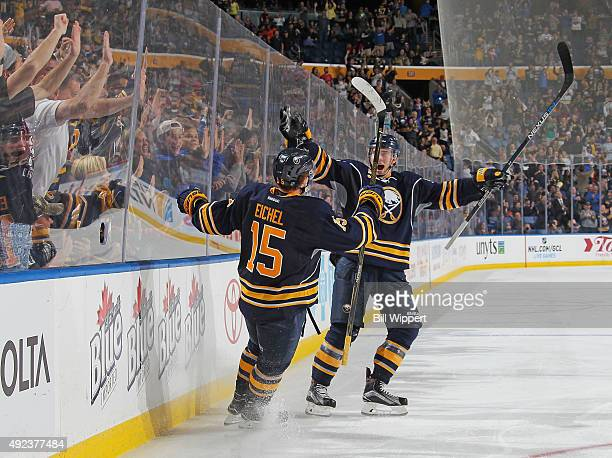 Jack Eichel of the Buffalo Sabres celebrates his third period goal with teammate Rasmus Ristolainen against the Columbus Blue Jackets on October 12...