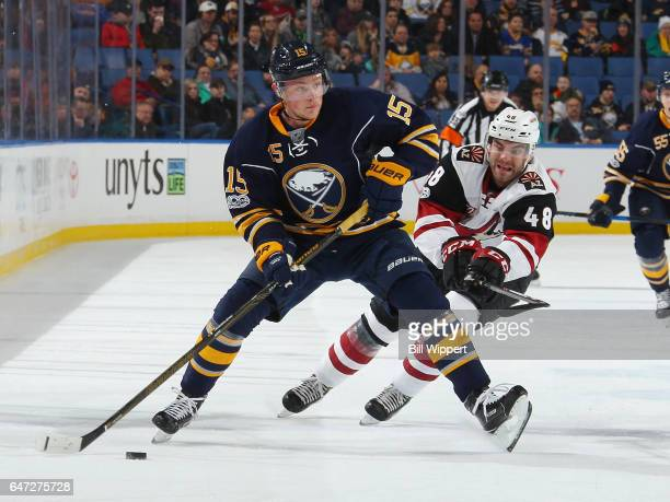 Jack Eichel of the Buffalo Sabres controls the puck against Jordan Martinook of the Arizona Coyotes during an NHL game at the KeyBank Center on March...