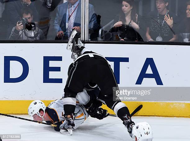 Jack Eichel of the Buffalo Sabres gets checked by Dwight King of the Los Angeles Kings during the game against the Buffalo Sabres on February 27 2016...