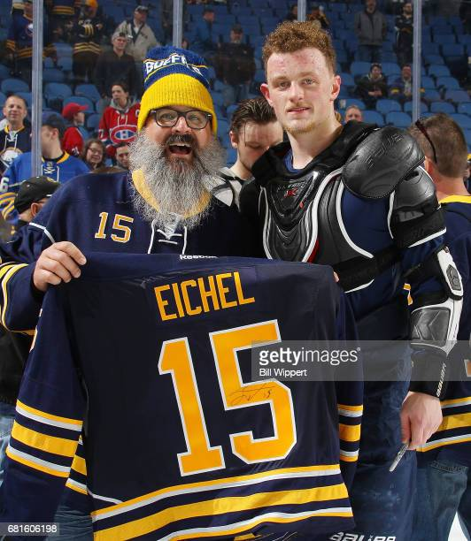 Jack Eichel of the Buffalo Sabres right gives his jersey to a fan after their NHL game against the Montreal Canadiens at KeyBank Center on April 5...
