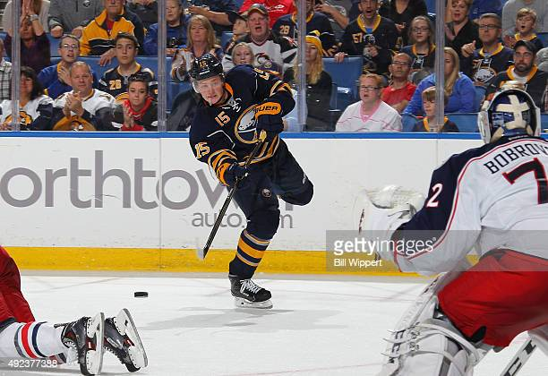 Jack Eichel of the Buffalo Sabres scores a third period goal against Sergei Bobrovsky of the Columbus Blue Jackets on October 12 2015 at the First...