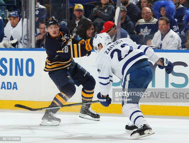 Jack Eichel of the Buffalo Sabres shoots the puck against Nikita Zaitsev of the Toronto Maple Leafs during an NHL game at the KeyBank Center on March...
