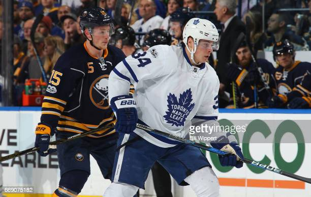 Jack Eichel of the Buffalo Sabres skates against Auston Matthews of the Toronto Maple Leafs during an NHL game at the KeyBank Center on April 3 2017...