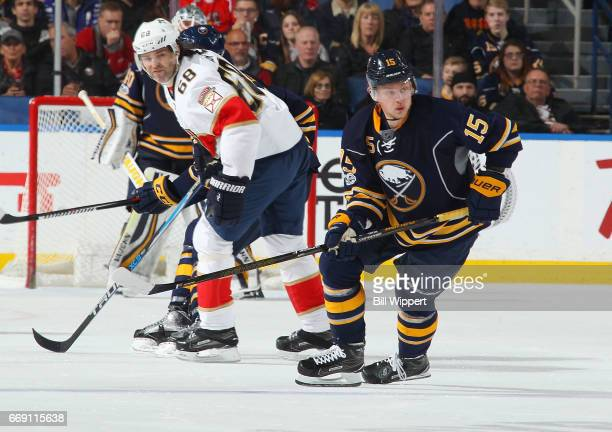 Jack Eichel of the Buffalo Sabres skates against Jaromir Jagr of the Florida Panthers during an NHL game at the KeyBank Center on March 27 2017 in...