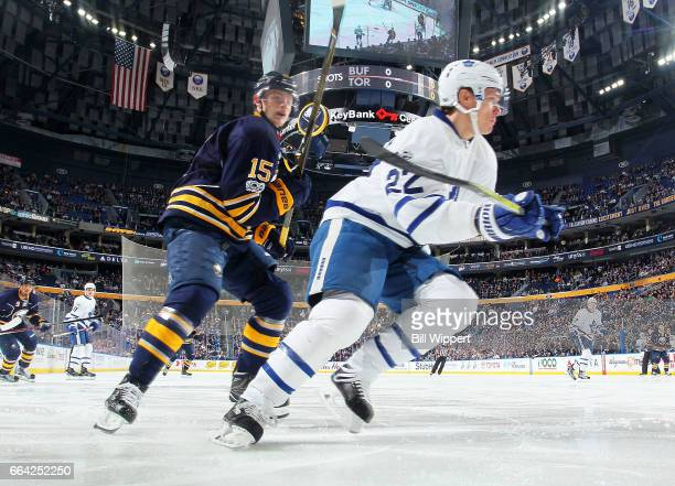 Jack Eichel of the Buffalo Sabres skates against Nikita Zaitsev of the Toronto Maple Leafs during an NHL game at the KeyBank Center on April 3 2017...