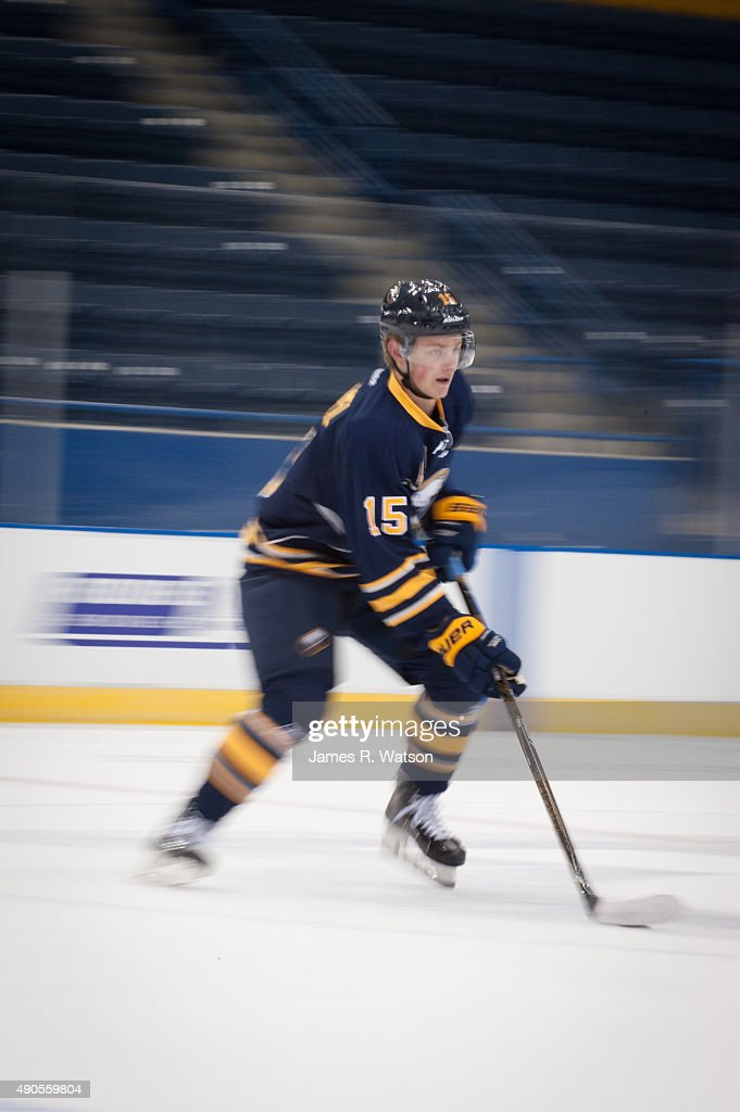 Jack Eichel #15 of the Buffalo Sabres skates with the puck during a photo shoot at the 2015 NHLPA Rookie Showcase at Mattamy Athletic Centre on September 1, 2015 in Toronto , Ontario , Canada .