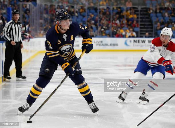 Jack Eichel of the Buffalo Sabres skates with the puck during the second period as Charles Hudon of the Montreal Canadiens defends at the KeyBank...
