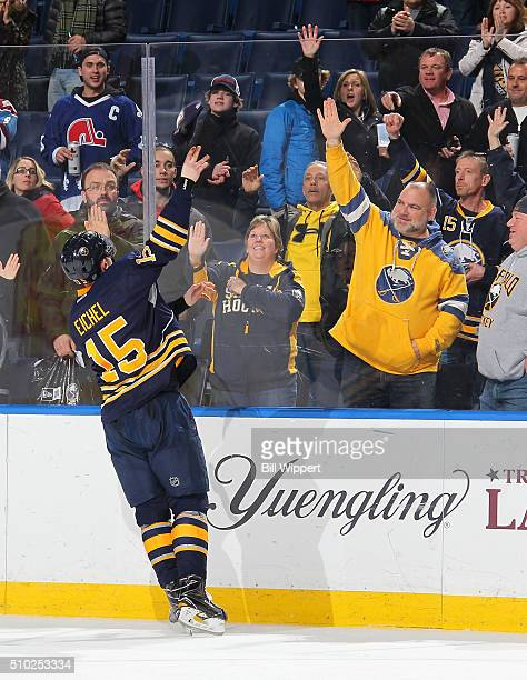 Jack Eichel of the Buffalo Sabres tosses a hat to fans after their 41 victory against the Colorado Avalanche in an NHL game on February 14 2016 at...