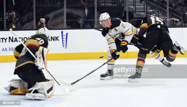 Jack Eichel of the Buffalo Sabres tries to get a shot off against Malcolm Subban of the Vegas Golden Knights as Jon Merrill of the Golden Knights...