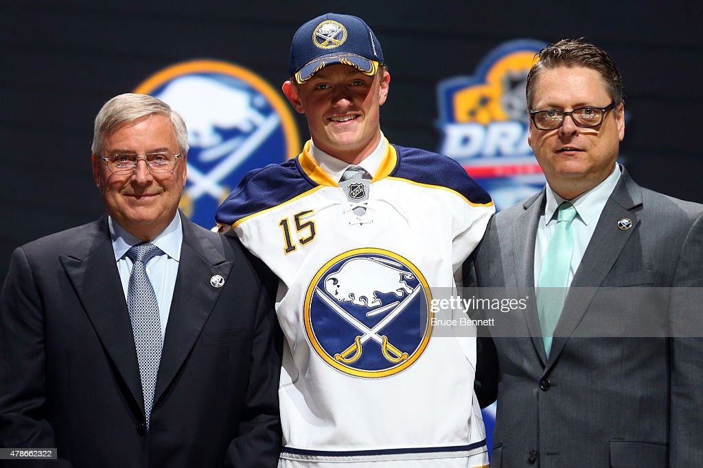 Jack Eichel poses on stage after being selected second overall by the Buffalo Sabres in the first round of the 2015 NHL Draft at BBT Center on June...