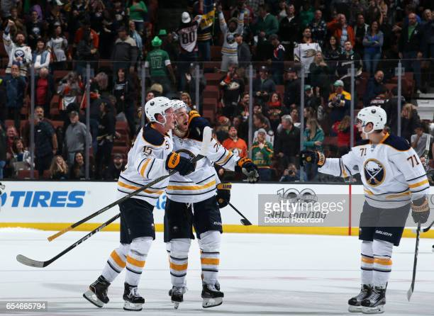 Jack Eichel Zemgus Girgensons and Evan Rodrigues of the Buffalo Sabres celebrate their 21 shootout win over the Anaheim Ducks on March 17 2017 at...