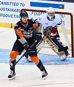 Jack Finn is screens by Vincent Scognamiglio of the Mississauga Steelheads of the Flint Firebirds during OHL game action on October 4 2015 at the...
