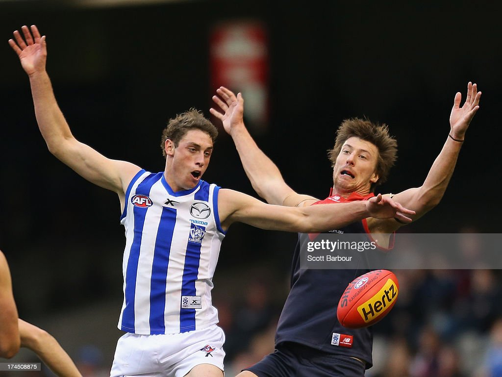 Jack Fitzpatrick of the Demons and Cameron Delaney of the Kangaroos compete for the ball the round 18 AFL match between the Melbourne Demons and the North Melbourne Kangaroos at Etihad Stadium on July 27, 2013 in Melbourne, Australia.