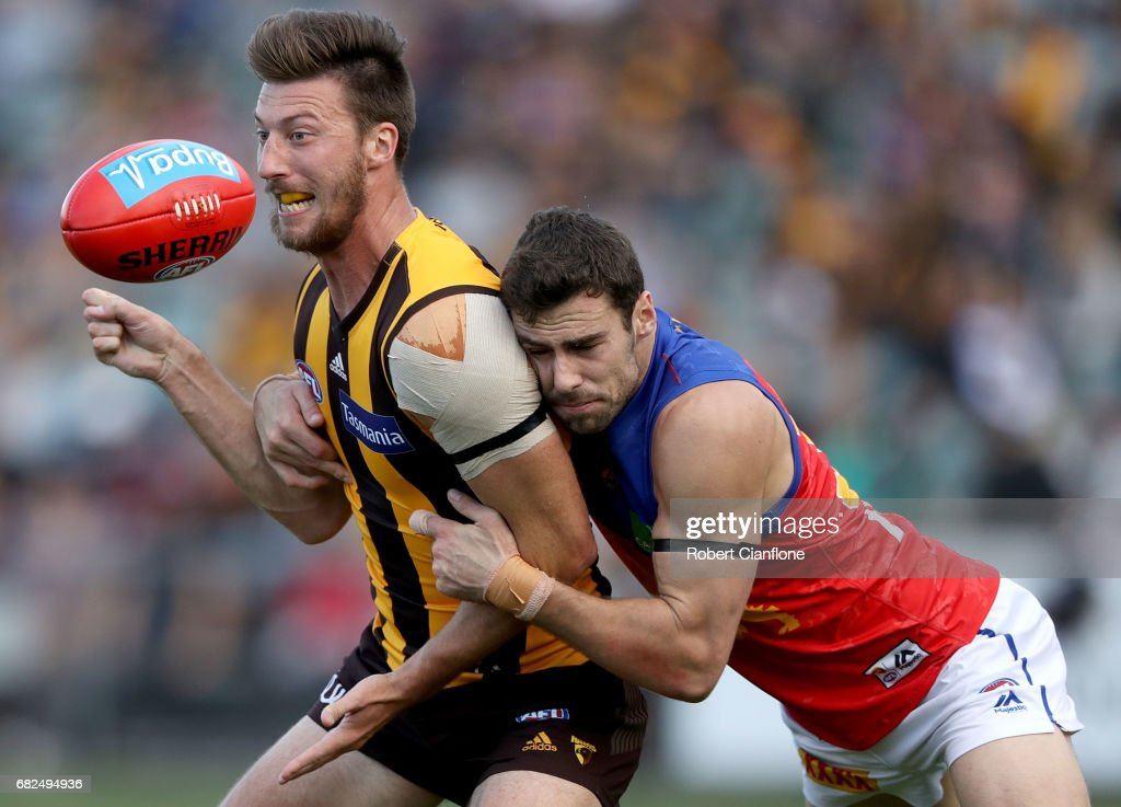 Jack Fitzpatrick of the Hawks is challenged by Michael Close of the Lions during the round eight AFL match between the Hawthorn Hawks and the Brisbane Lions at University of Tasmania Stadium on May 13, 2017 in Launceston, Australia.