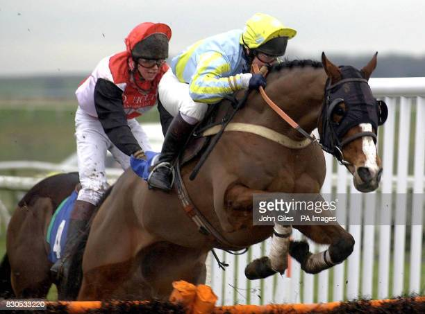Jack Flush ridden by Jim Crowley clears the last from Lucky Ganesha ridden by Dominic Elsworth for victory in the Dinsdale Conditional Jockeys'...