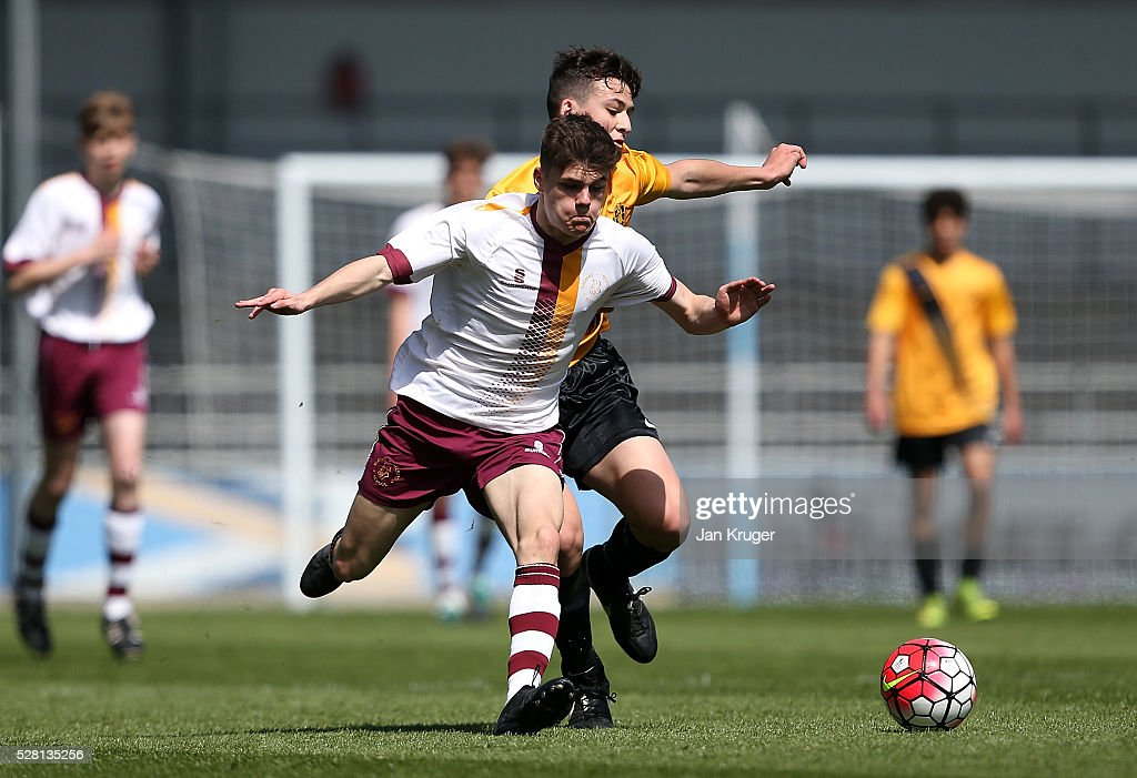Jack Foggin of Thomas Telford School(L) battles with Lewis Jones of Samuel Whitbread Academy during the under 16 Schools' Cup final match between Thomas Telford School and Samuel Whitbread Academy at the Academy Training Ground on May 04, 2016 in Manchester, England.