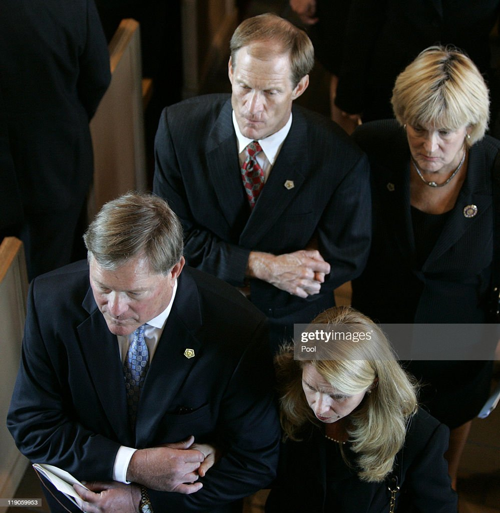 Jack Ford with his wife Julianne and Mike Ford with his wife Gayle right leave at the end of the funeral for former first lady Betty Ford is carried...