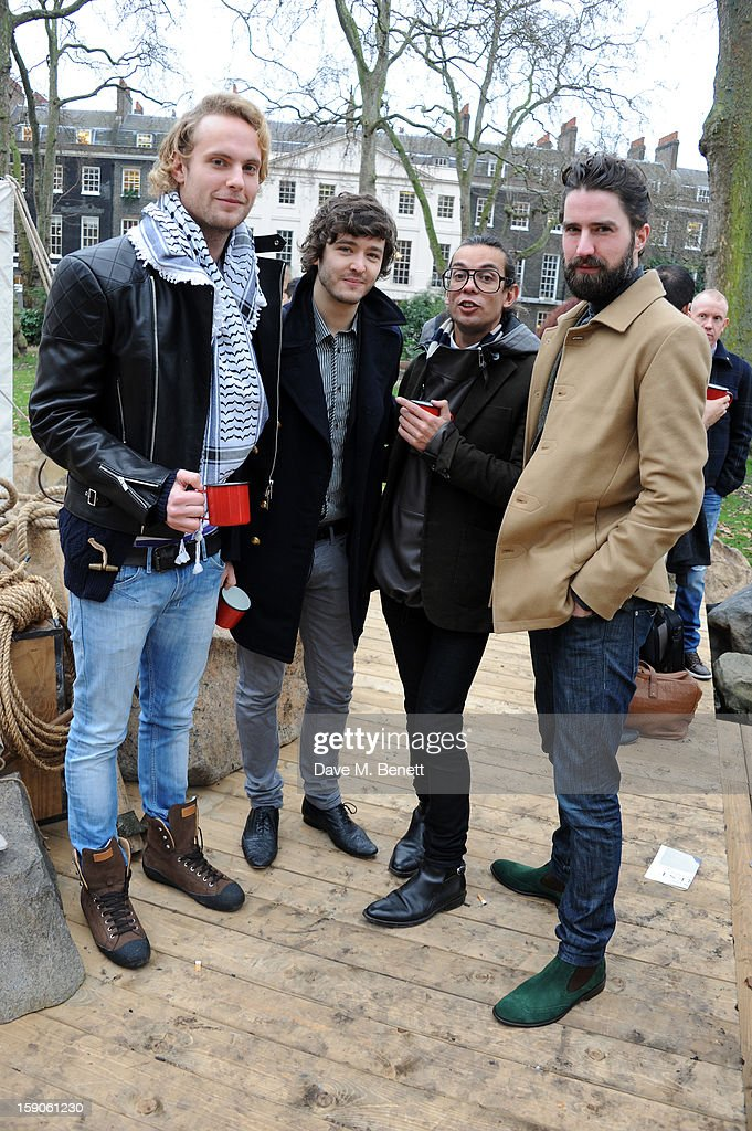 ) Jack Fox, Alexander Vlahos, Bally designer Michael Herz and Jack Guinness attend the 'BALLY Celebrates 60 Years of Conquering Everest' at Bedford Square Gardens on January 7, 2013 in London, England.