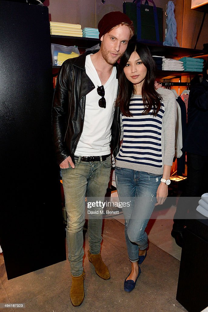 Jack Fox and <a gi-track='captionPersonalityLinkClicked' href=/galleries/search?phrase=Gemma+Chan&family=editorial&specificpeople=6928347 ng-click='$event.stopPropagation()'>Gemma Chan</a> attend the Lacoste Store Reopening on May 28, 2014 in London, England.