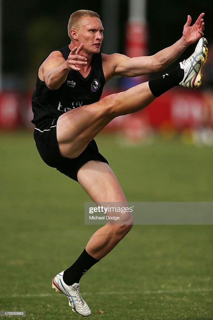 Jack Frost kicks the ball during a Collingwood Magpies AFL training session at Olympic Park on February 20, 2014 in Melbourne, Australia.
