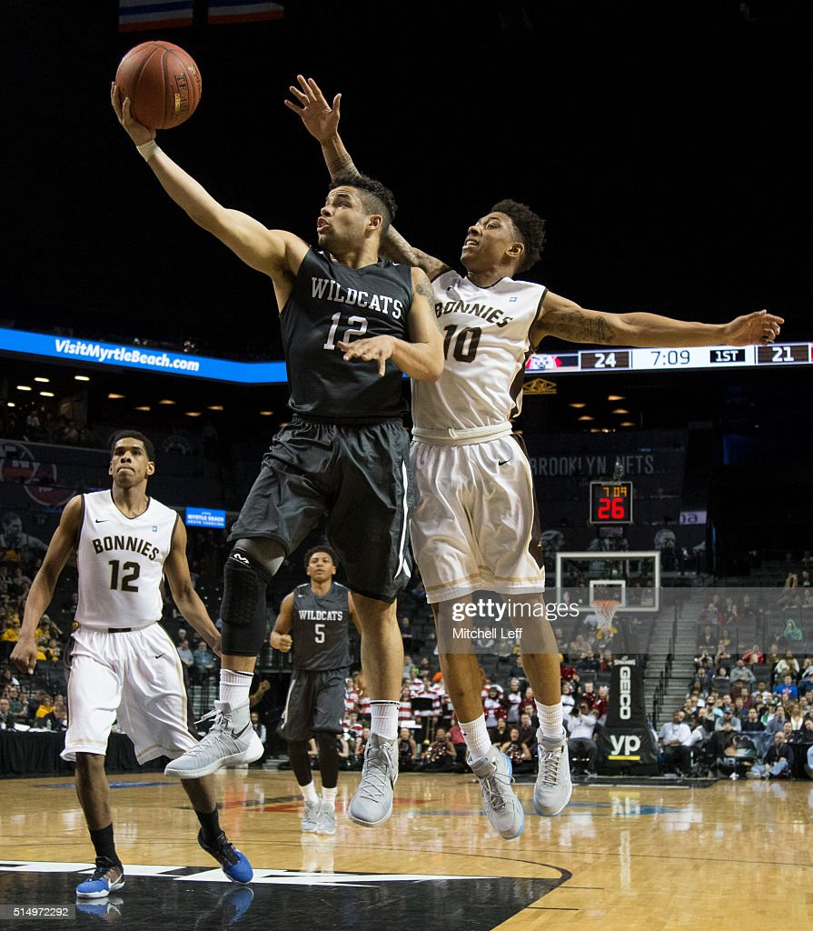 Jack Gibbs of the Davidson Wildcats attempts a shot against Jaylen Adams of the St Bonaventure Bonnies in the quarterfinals round of the men's...