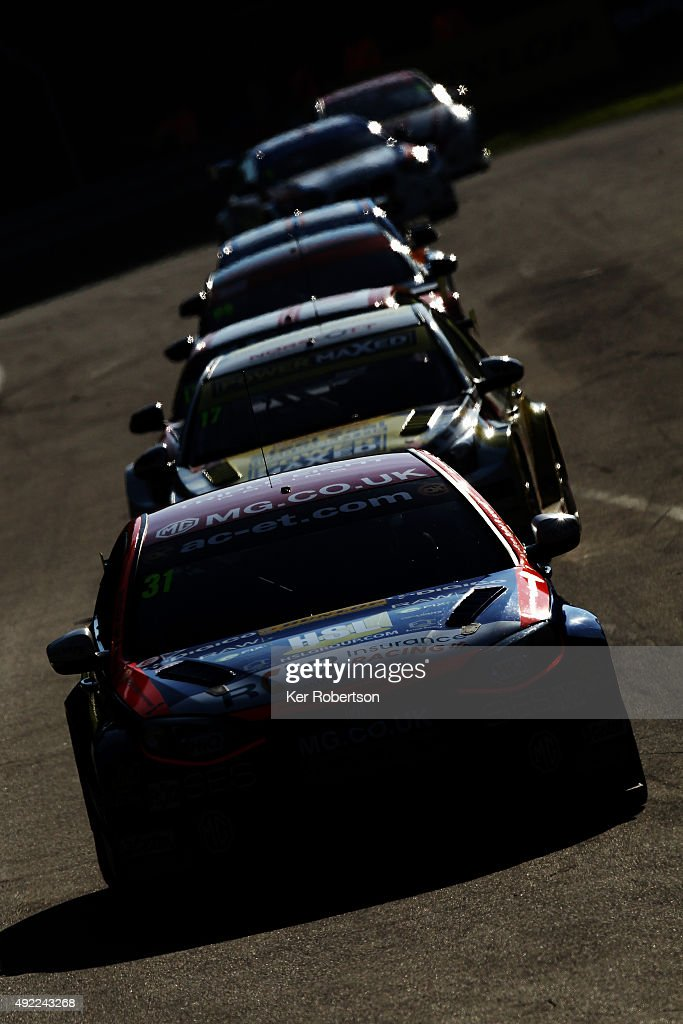 Jack Goff of MG 888 Racing leads a pack of cars during Race Two of the Final Round of the Dunlop MSA British Touring Car Championship at Brands Hatch on October 11, 2015 in Longfield, England.