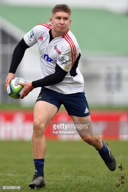 Jack Goodhue looks to pass the ball during a Crusaders Super Rugby training session at Rugby Park on July 27 2017 in Christchurch New Zealand