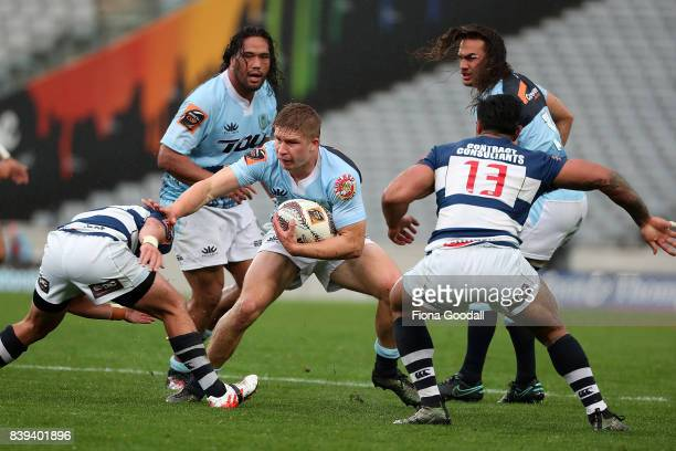 Jack Goodhue of Northland fends during the round two Mitre 10 Cup match between Auckland and Northland at Eden Park on August 26 2017 in Auckland New...