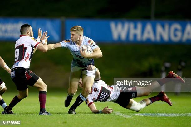 Jack Goodhue of Northland is tackled by Bryn Hall of North Harbour during the round five Mitre 10 Cup match between Northland and North Harbour at...