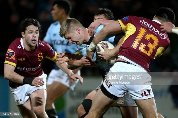 Jack Goodhue of Northland is tackled by Matt Johnson of Southland during the round three Mitre 10 Cup match between Southland and Northland at Rugby...