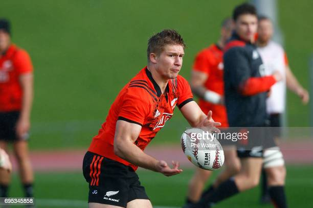 Jack Goodhue of the All Blacks passes during a New Zealand All Blacks training session at Trusts Stadium on June 13 2017 in Auckland New Zealand