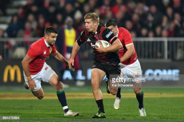 Jack Goodhue of the Crusaders charges forward during the match between the Crusaders and the British Irish Lions at AMI Stadium on June 10 2017 in...