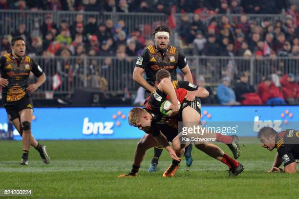 Jack Goodhue of the Crusaders charges forward during the Super Rugby Semi Final match between the Crusaders and the Chiefs at AMI Stadium on July 29...