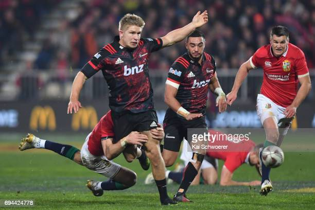 Jack Goodhue of the Crusaders is tackled during the match between the Crusaders and the British Irish Lions at AMI Stadium on June 10 2017 in...