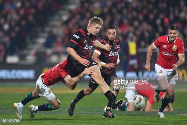 Jack Goodhue of the Crusaders kicks the ball during the match between the Crusaders and the British Irish Lions at AMI Stadium on June 10 2017 in...