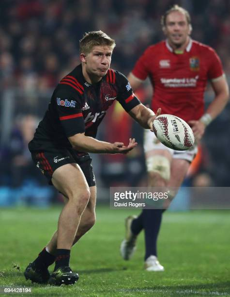 Jack Goodhue of the Crusaders passes the ball during the 2017 British Irish Lions tour match between the Crusaders and the British Irish Lions at the...